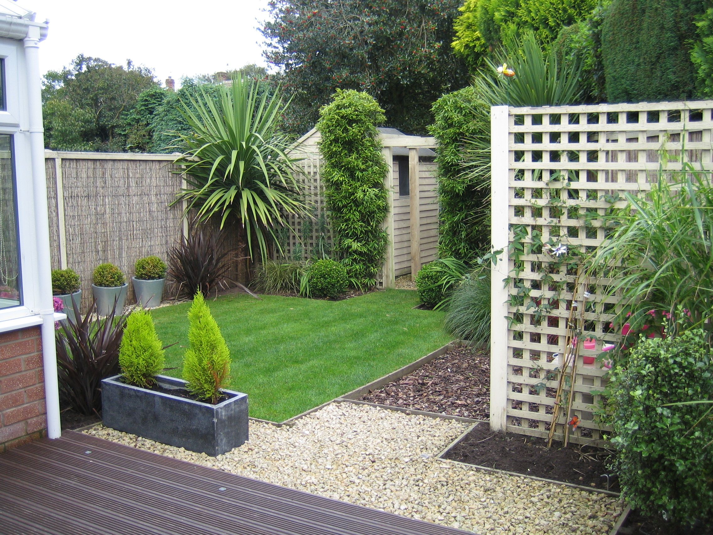 Willow panels with cream painted surround used to clad for Garden fence designs uk
