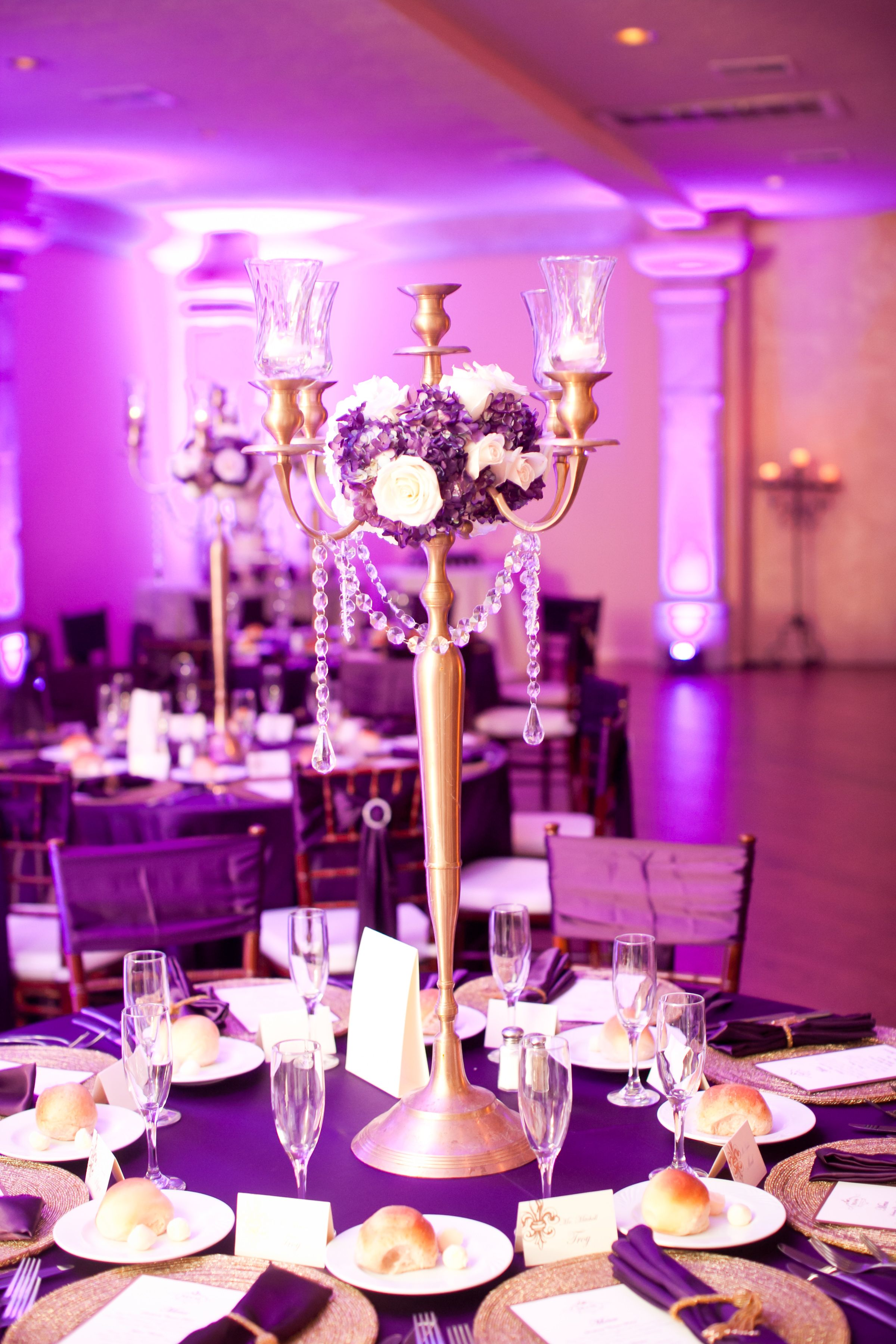 Centerpieces Gold candelabras with crystals and purple flowers | My ...