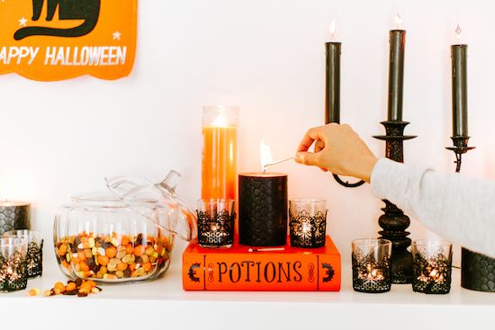 Black and orange candles arranged with Halloween decor Holidays