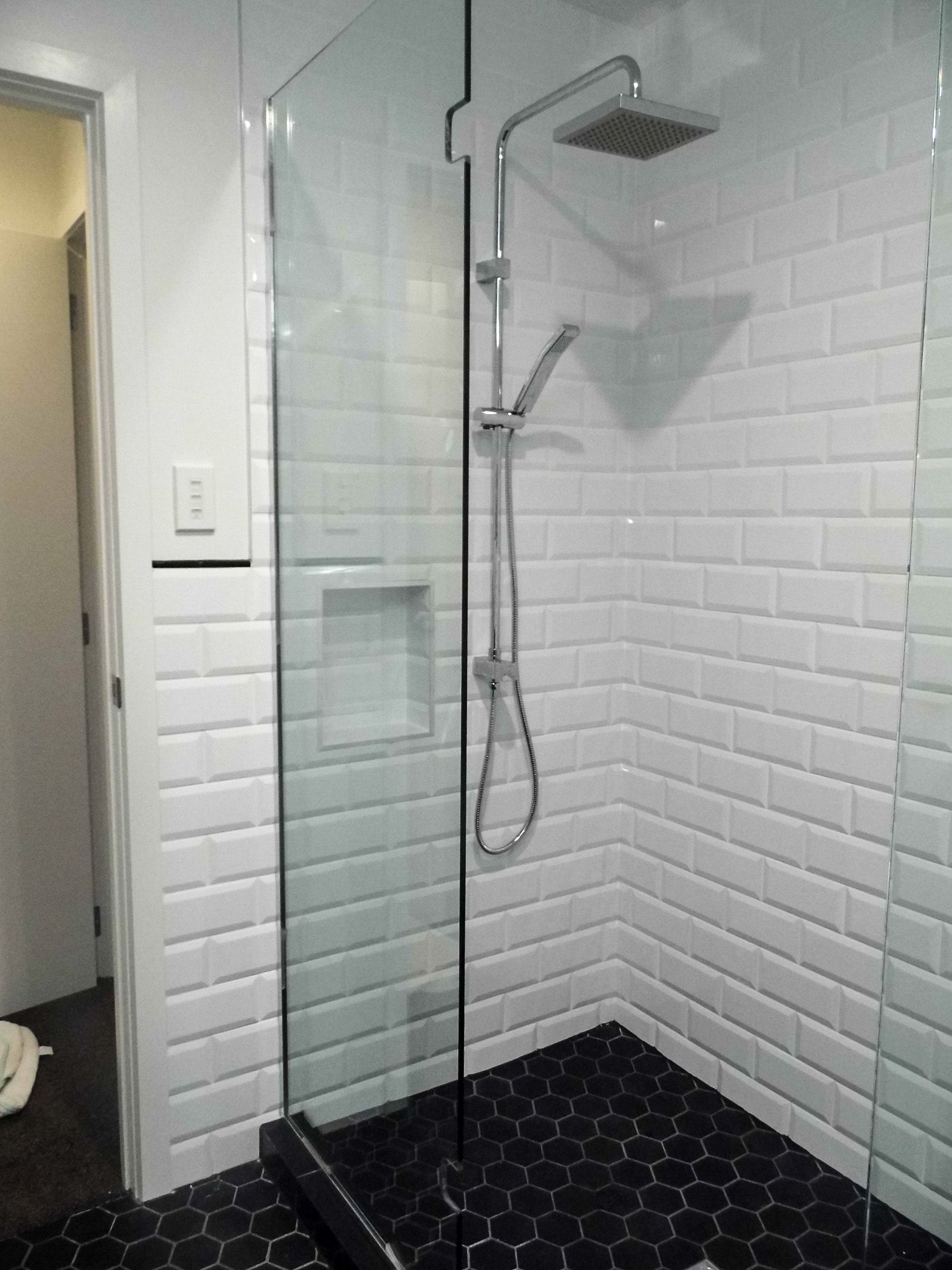 Charcoal bathroom tiles google search bathroom inspiration heritageimagesproductsbevelled wall tileswhite bevelled tiled shower and black hexagon floor tiles dailygadgetfo Gallery