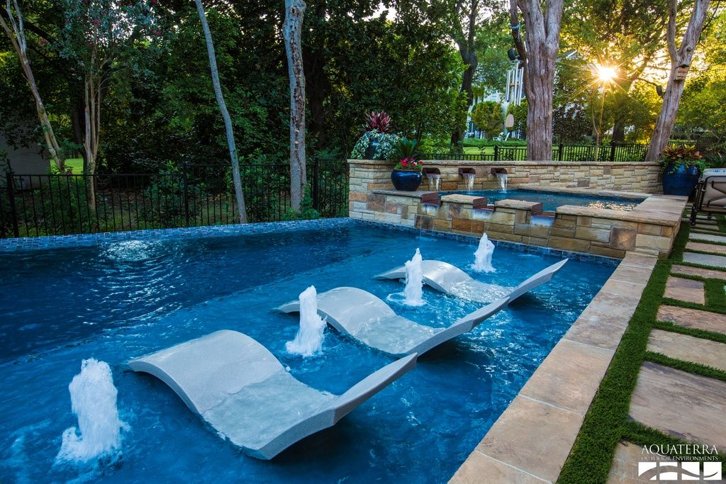Traditional swimming pool with pool with hot tub fountain for Garden pool loungers