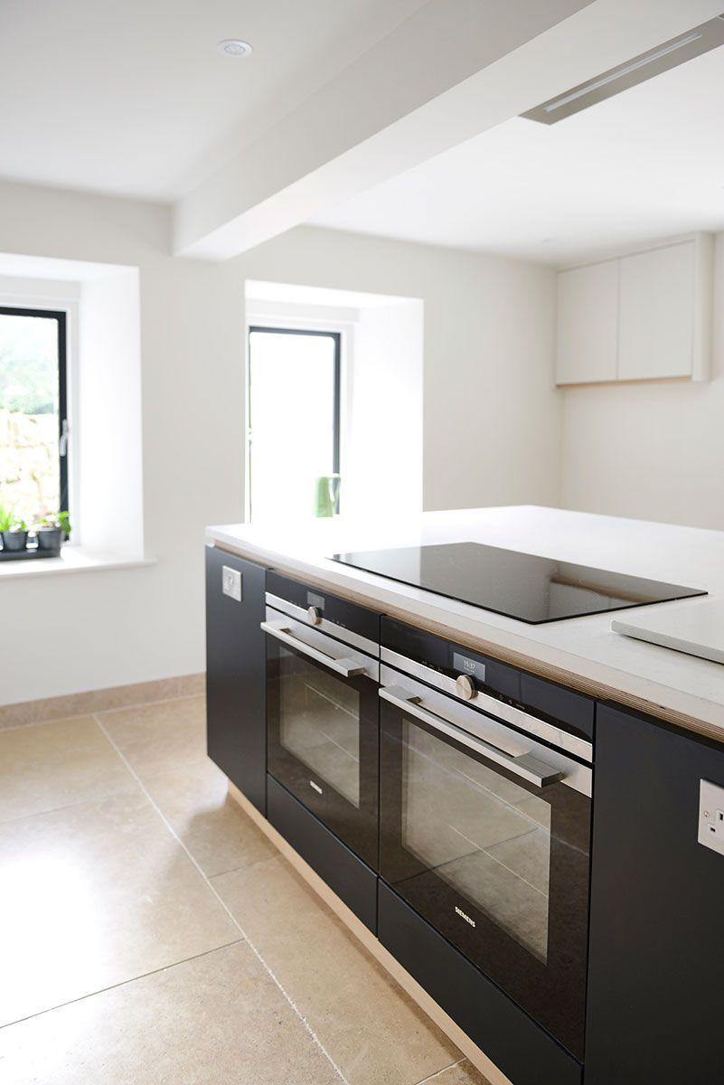Contemporary kitchen with twin cooker with Snowy Ibiza Silestone ...