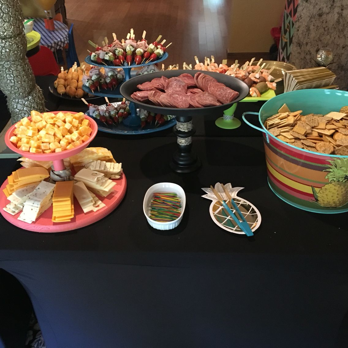 Snack table set up. & Snack table set up. Housewarming party. Skewers cheeses crackers ...