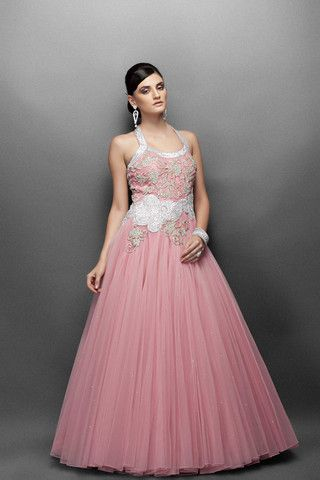 This Pink color Indo western gown has halter neck. This bridal gown have  gold silver work in a fitted bodice and silver zircon work in paisley motif  around ... 60d1e4267c3a