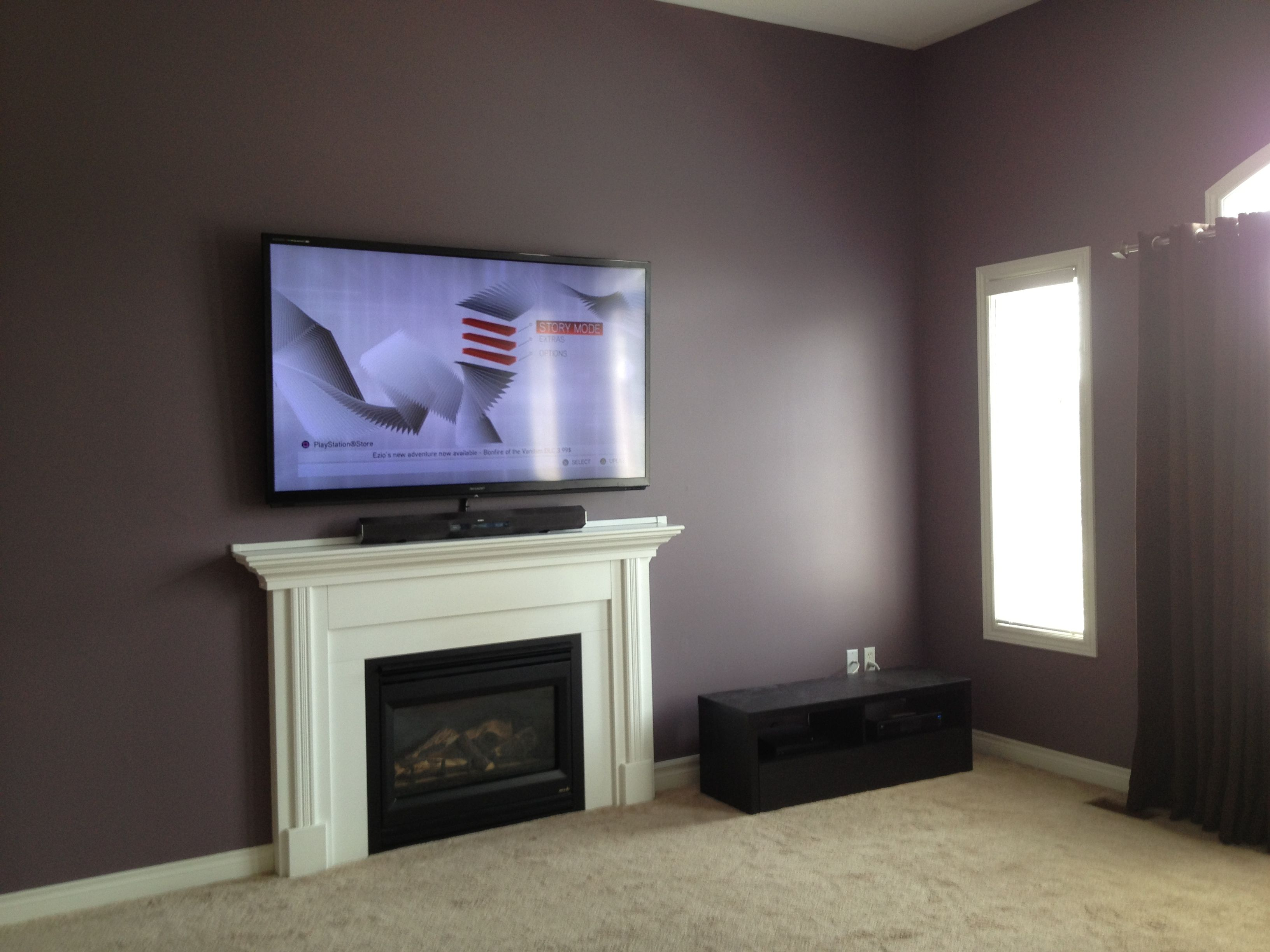Sony Sound Bar Standing On Top Of The Fireplace Mantle