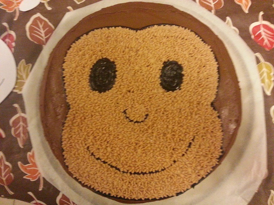 Monkey face cake. You can add ears by taking an 2 oreo cookiea and using the top cookie part and put in the side of the cake.