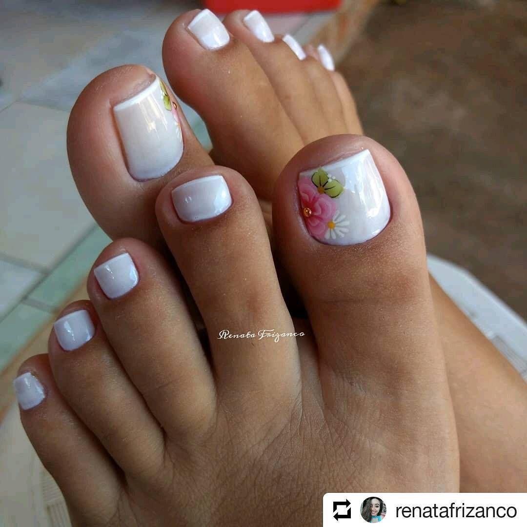 Subtle French Tip Pedicure And Floral Design Summer Toe Nails Toe Nail Color Pedicure Designs Toenails