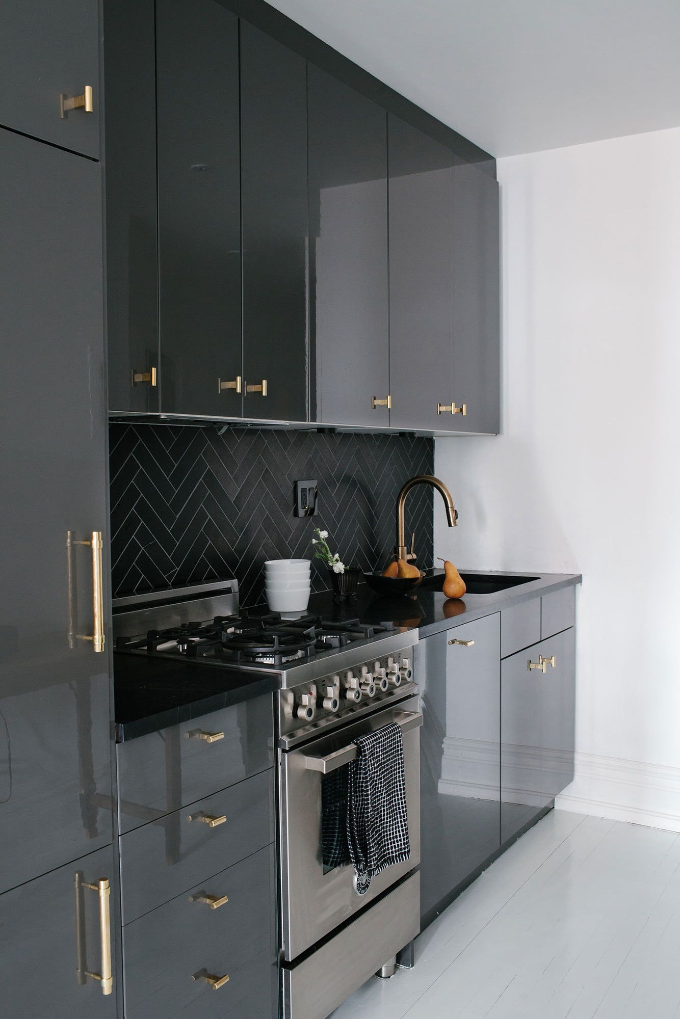 A Black And White Bachelor Pad In Brooklyn Kitchen Design Small Contemporary Kitchen Black Kitchen Cabinets