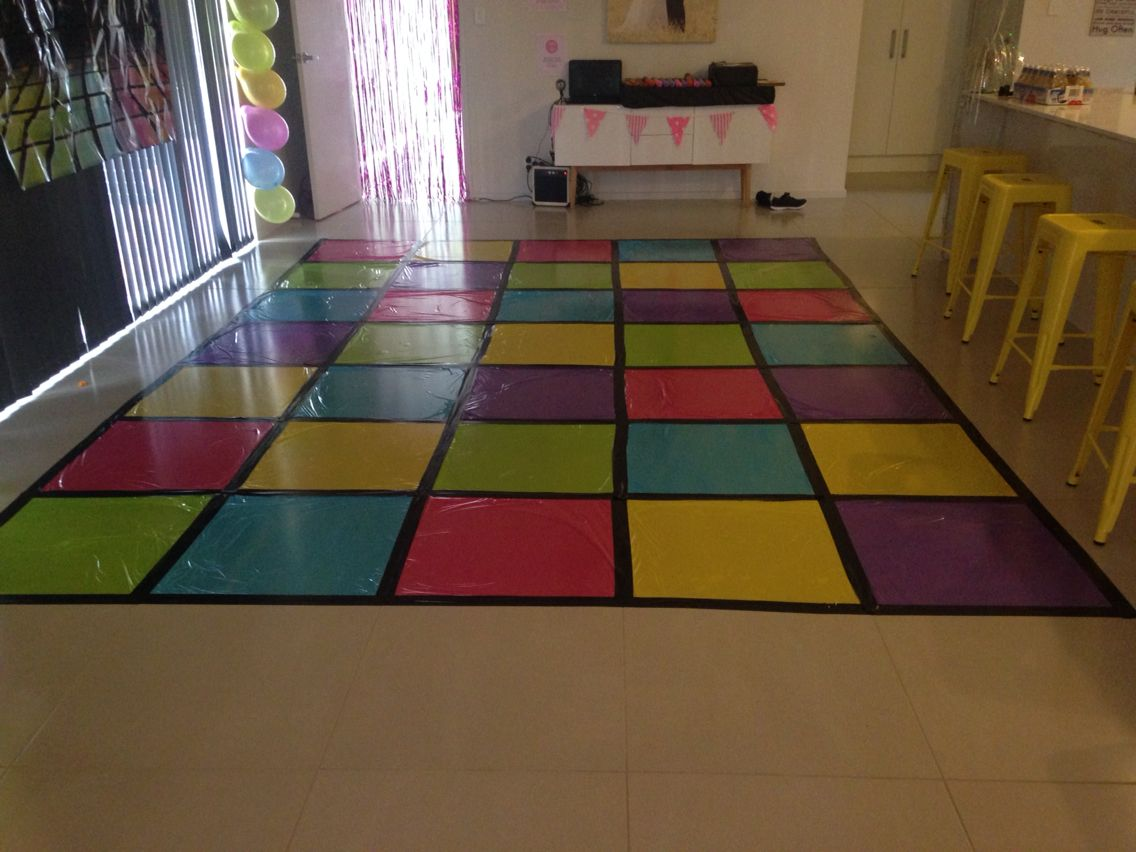 Disco Dance Floor Made From Plastic Tables Cloths And Black Duck Tape Stuck To The Tiles Dance Party Decorations 70s Party Theme Disco Party Decorations