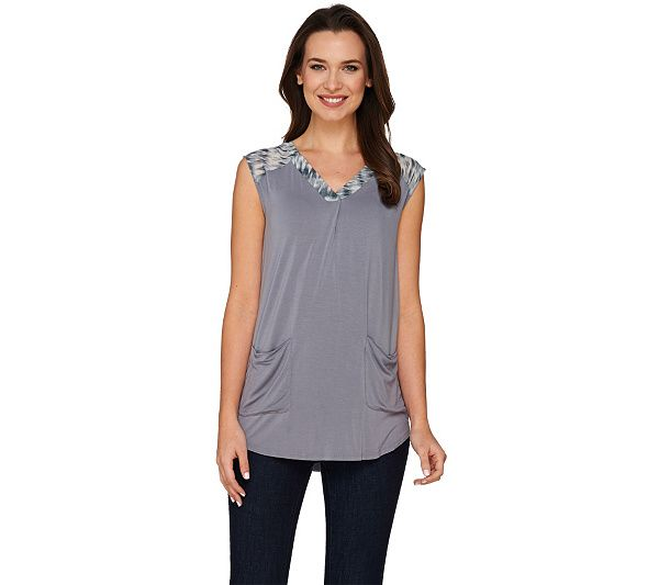 Love your look with this LOGO top. Knit yet light for warm-weather wear, it's styled with a V-neckline and printed chiffon trim that decorates the back yoke and shoulders. QVC.com
