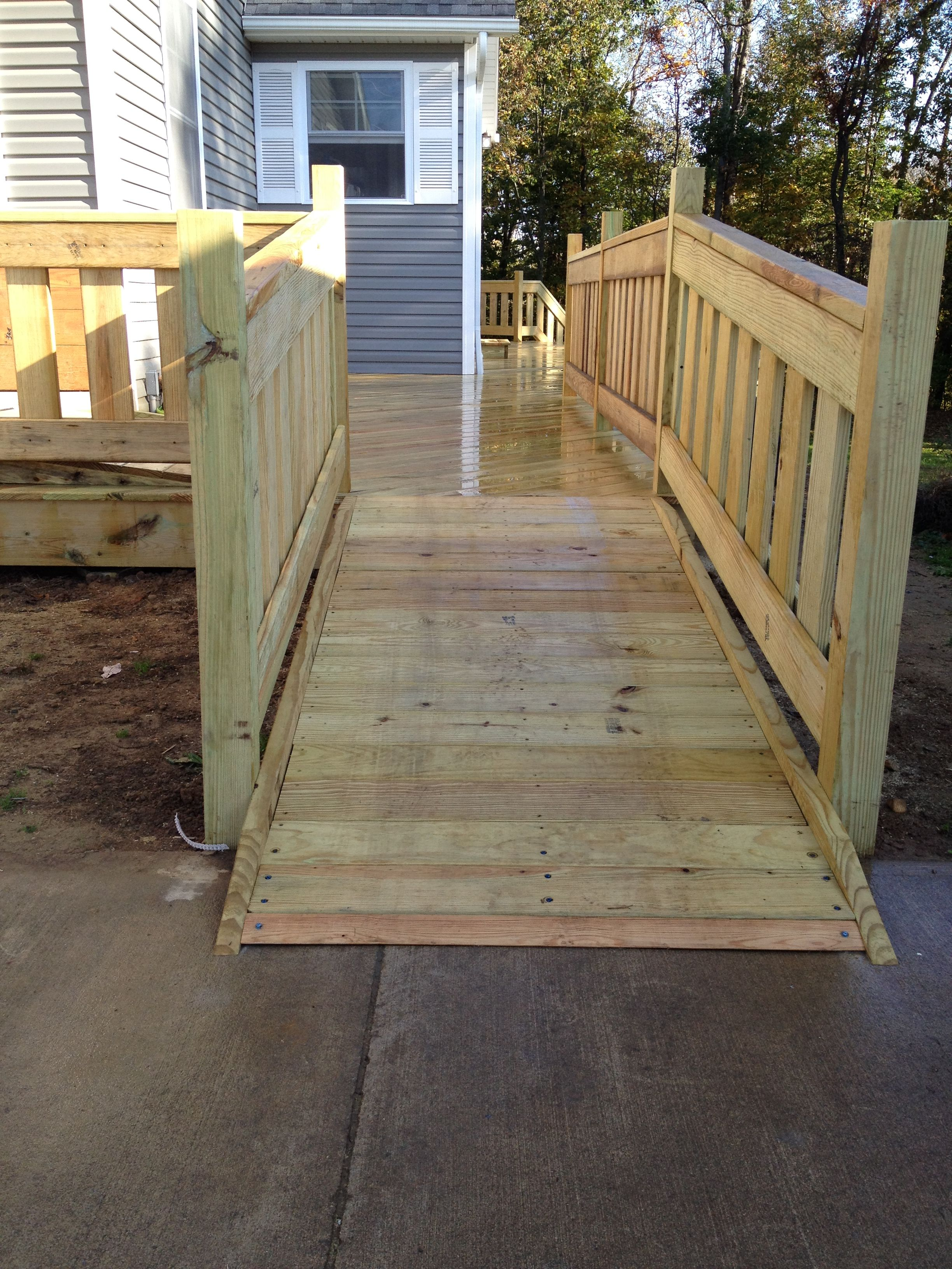 Custom Treated Lumber Handicap Ramp And Railings For The Deck.