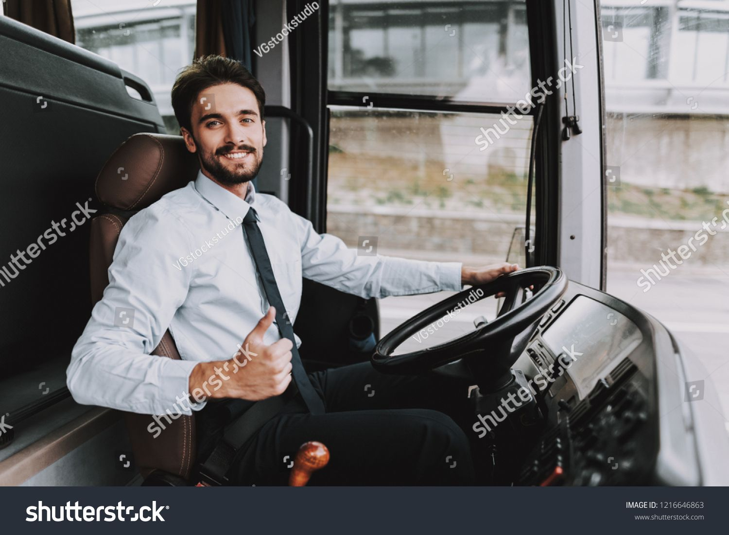Smiling Man Driving Tour Bus Professional Driver Young Happy Man Wearing White Shirt And Black Tie Sitting On Driver Seat Travel And Tourism Smiling Man Bus