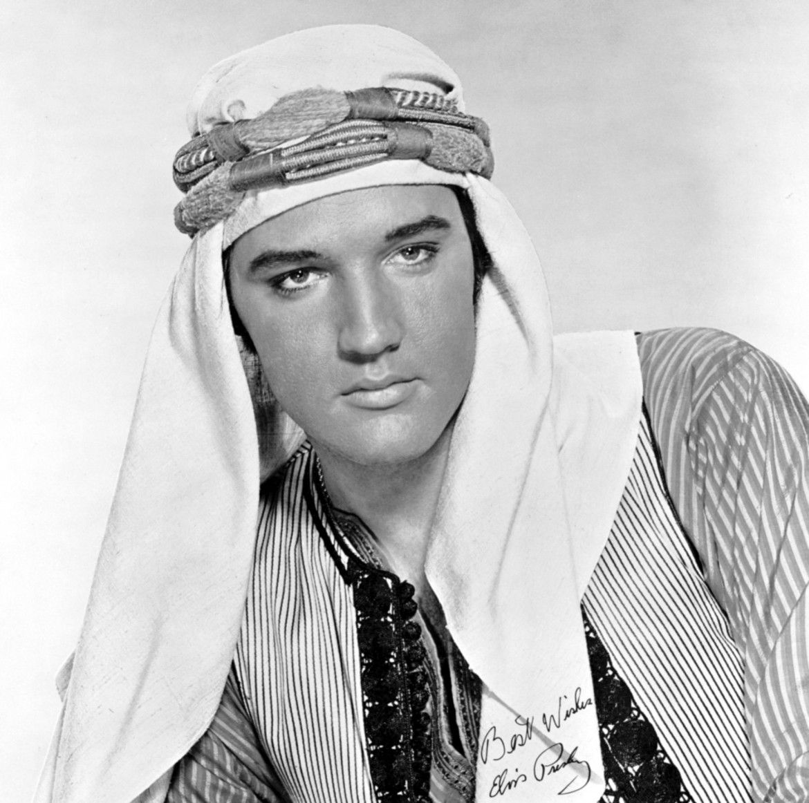 Wearing a keffiyeh, Elvis poses for a promotional image for the 1965 film Harum Scarum.
