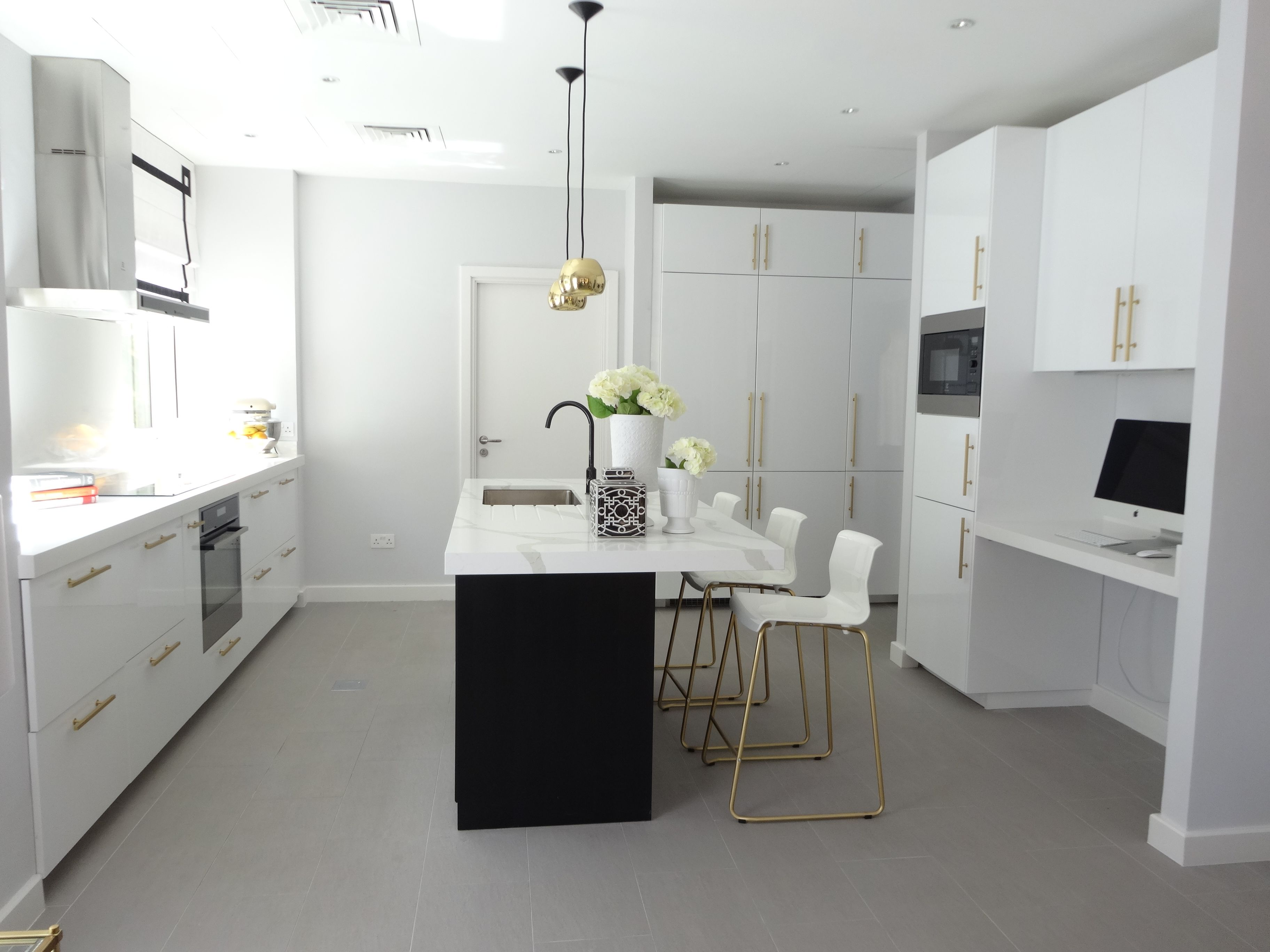 Black & white kitchen with brass and gold accessories high gloss