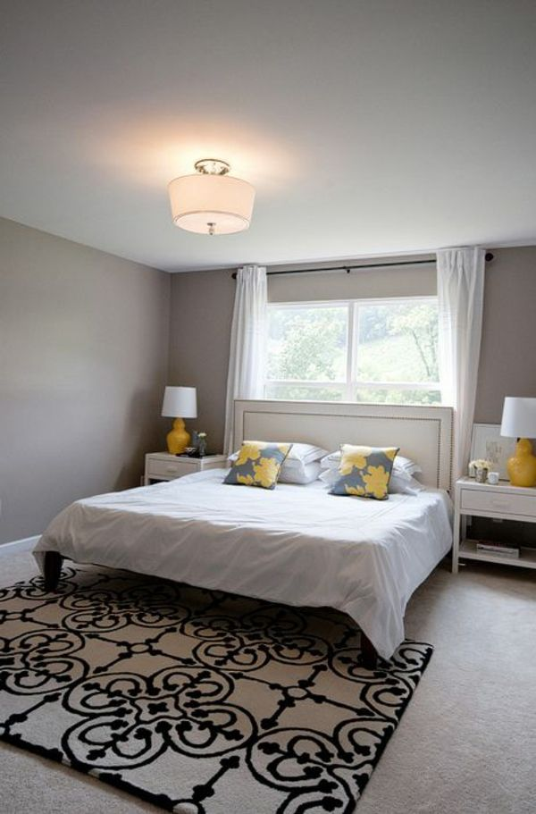 schlafzimmer design wandfarbe grautöne bett teppich gelbe akzente - moderne schlafzimmer farben