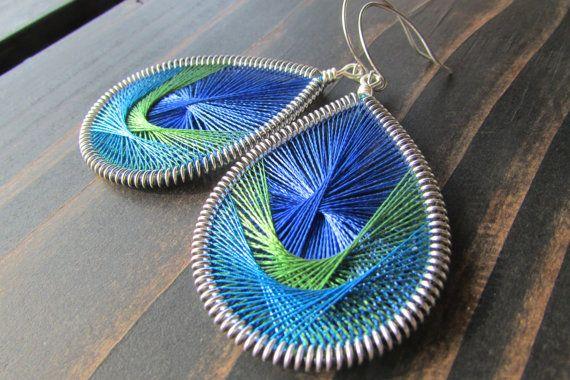 These Peruvian thread earrings are made with beautiful blue, olive green and metallic blue colors. They are created with colorful embroidery thread making them easy and fun earrings to coordinate with any outfit or scarf. The outer wire is hand coiled using silver wire and every pair is hand formed making each one a unique, one-of-a-kind piece. This pair measures about 3 gummy bears (about 2.5 in, 6.5 cm) from the top of the ear hook to the base.  You can also choose these in either of my…
