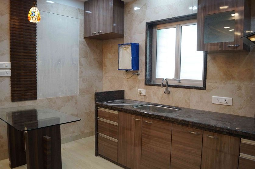 large kitchen with granite countertop and glass window design by arpita doshi interior designer on kitchen interior with window id=52258