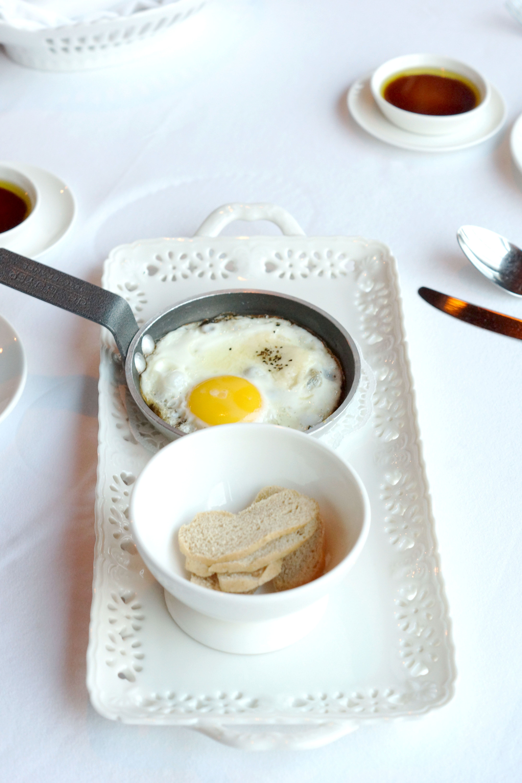 Pan Fried Eggs Tegamino With Black Truffle Puree And Mixed Cheese Fondue
