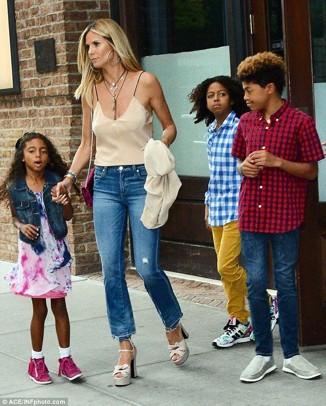e8f4d26067122 Sunkissed: Heidi Klum looked fantastic as she stepped out in New York with  her children on Tuesday