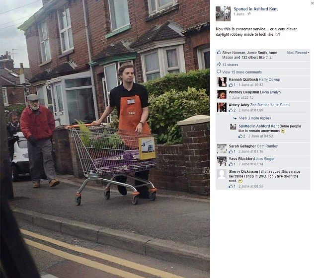 B&Q worker Ed Stubbs pushes the trolley of a pair of elderly customers from the store in A...