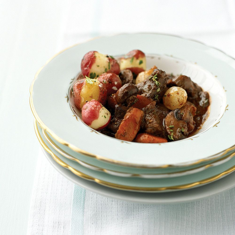 Easy Holiday Menus Two French classics -- a beef stew cooked in wine and mini cream puffs -- play starring roles in this scrumptious feast.  MainBoeuf Bourguignon  SidePotatoes with Parsley  SaladWatercress, Frisee, and Pear Salad  DessertCream Puffs