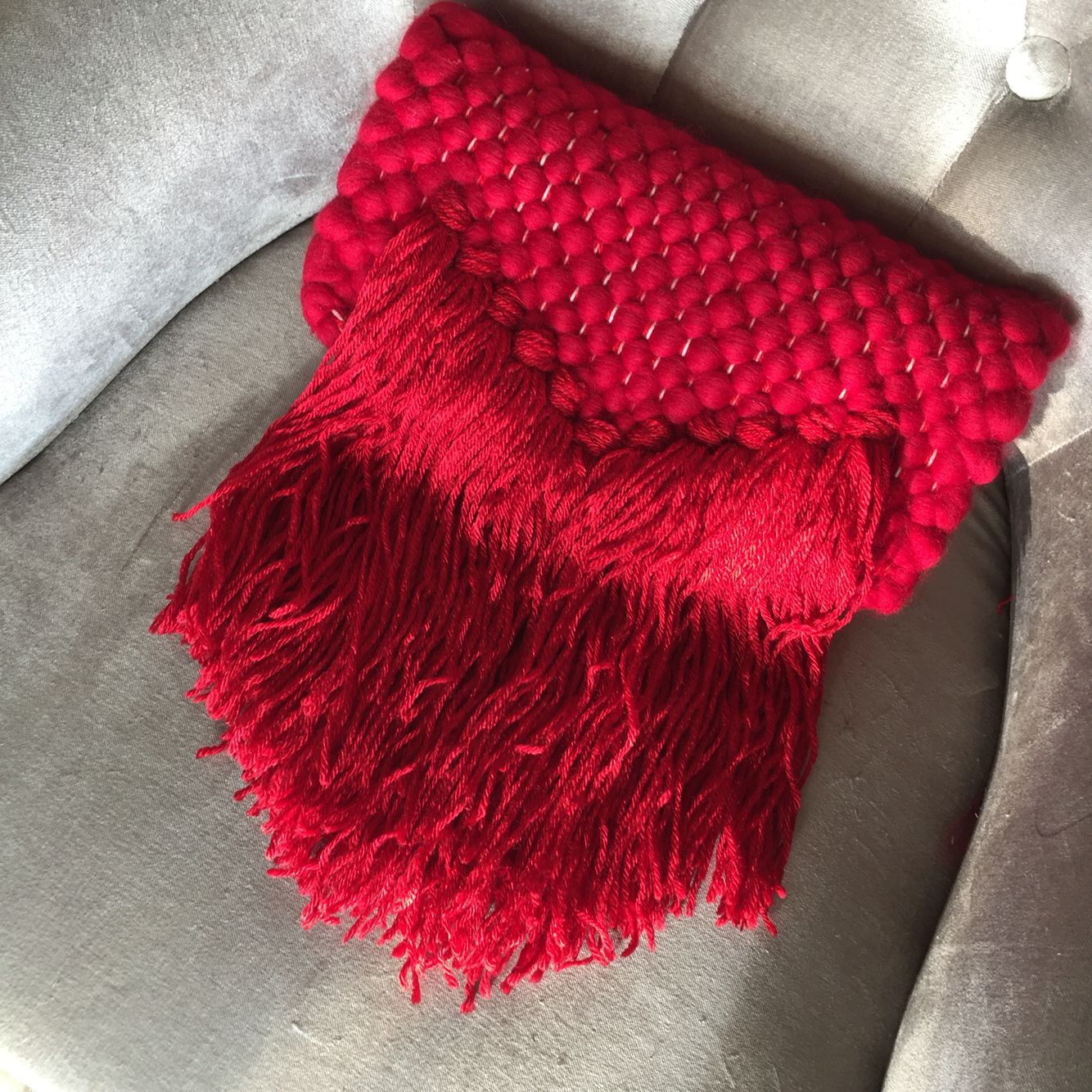 Woven red merino wool clutch with tassels