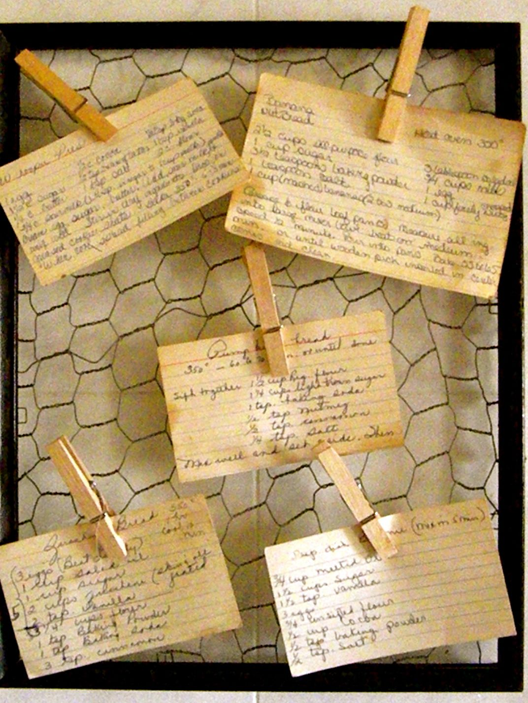 picture frame, chicken wire, and clothespins as a recipe card holder