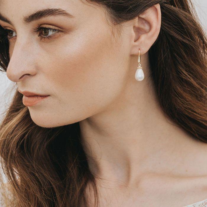 Ana gold teardrop pearl earrings#ana #earrings #gold #pearl #teardrop