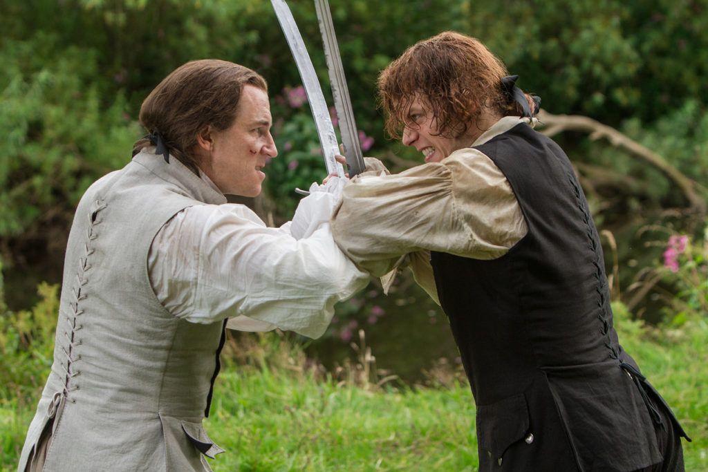 "Black Jack Randall (Tobias Menzies) and Jamie Fraser (Sam Heughan) in Episode 206 ""Best Laid Schemes"" of Outlander Season 2 on Starz"