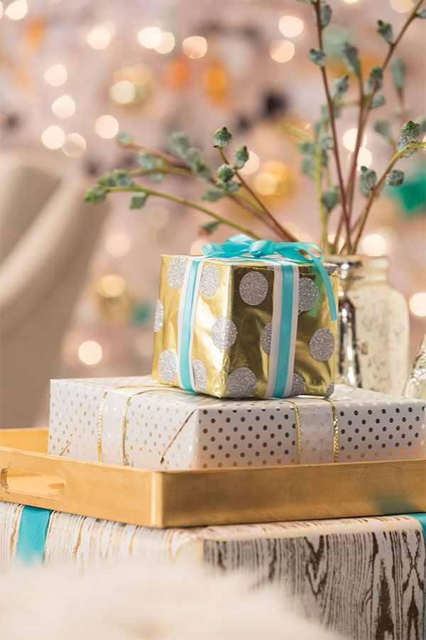 So. Simple. Wrap large presents or boxes and use them as side tables during the holidays. Complete the look with this Target gold tray. Goregous!