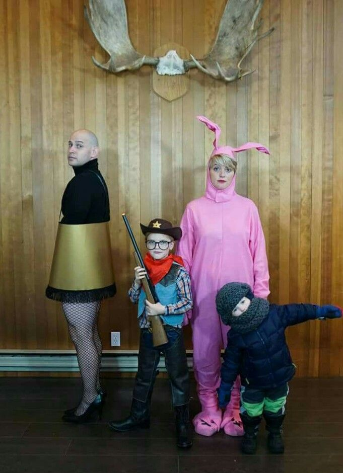 a christmas story family photo with the leg lamp ralphie and the red ryder bb gun the bunny pajamas and randy in a snow suit