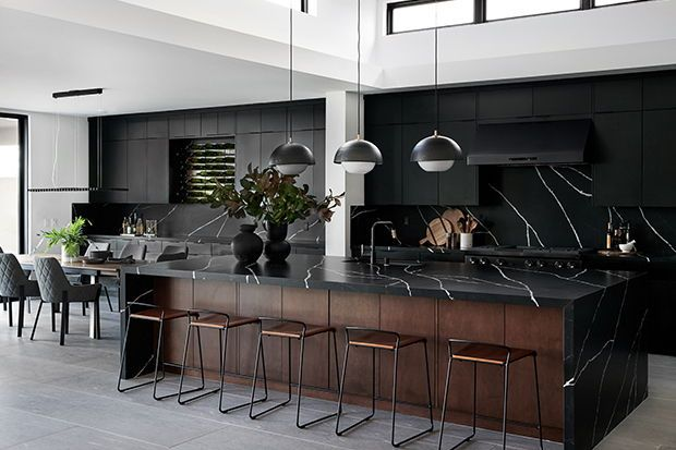 For this San Diego showhome, Bobby created a dramatic black kitchen with an adjacent dining room. | Photographer: Tessa Neustadt | Designer: Bobby Berk