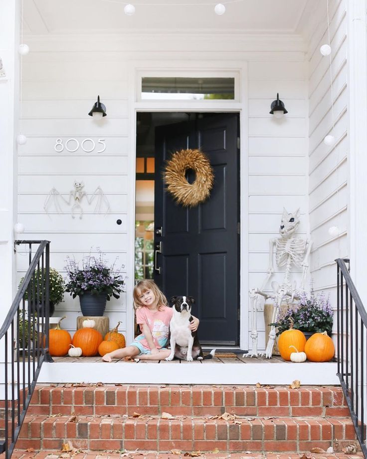 Happy Tuesday from this sick little lady and her furry sidekick! #falldecor #porchdecor