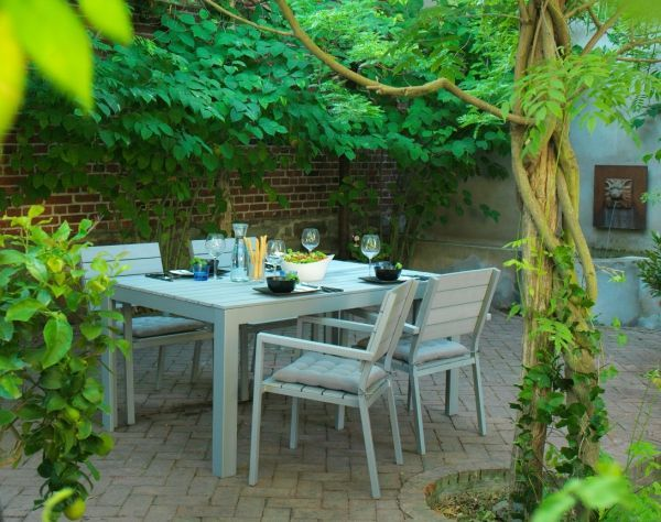 Made of durable plastic, the IKEA FALSTER outdoor furniture series has the look and feel of wood but doesn't require all the upkeep to create a comfortable outdoor dining space..