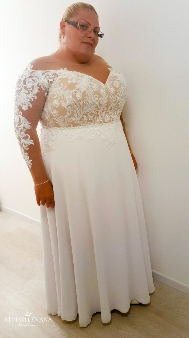Plus size white wedding dresses  Real plus size bride in a wedding gown with off shoulder illusion