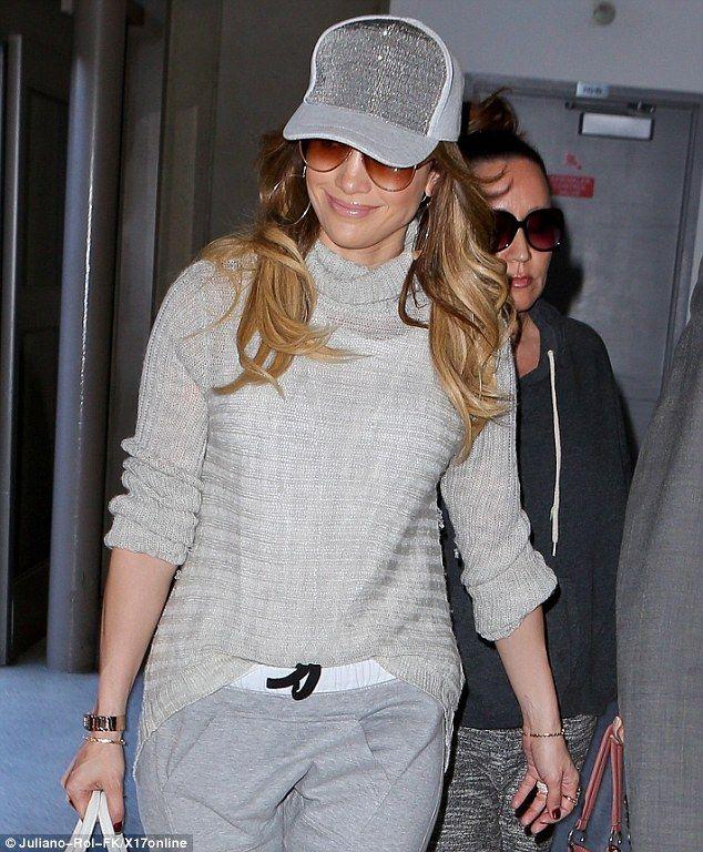 Jennifer Lopez Finally Aces the Glam-in-Sweatpants Look | Buy ➜ http://shoespost.com/jennifer-lopez-versace-medusa-white-sneakers-style/