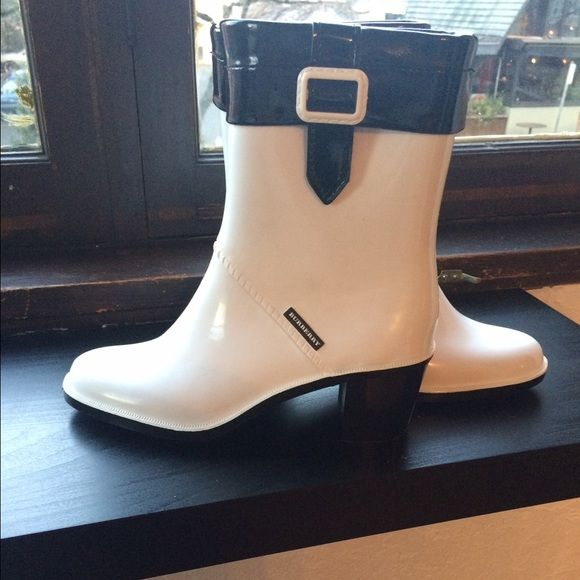Burberry heeled rainboots really cute Burberry rainboots. white and black outside with buckle-plaid inside. comes with original box. great condition. fits a 7-8 Burberry Shoes Winter & Rain Boots