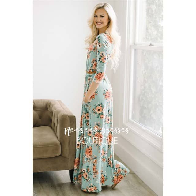 """Our super soft floral dresses just got a make over! Now coming in floor length, this maxi dress is as pretty and comfortable as they come! Mint maxi dress features a cute peachy floral print, elastic waist, 3/4 length sleeves and your favorite: front pockets! Belt and accessories not included.Total Length: 59""""95% Polyester 5% SpandexAmanda is a size 0/2, 5'8"""" and is wearing the S.SpecificationsAlphaXXSXSSMLXLXXL Numeric000 - 24 - 68 - 1012 - 141618 - 20  Bust30½ - 31½32 - 3333½ - 3536 - 3840…"""