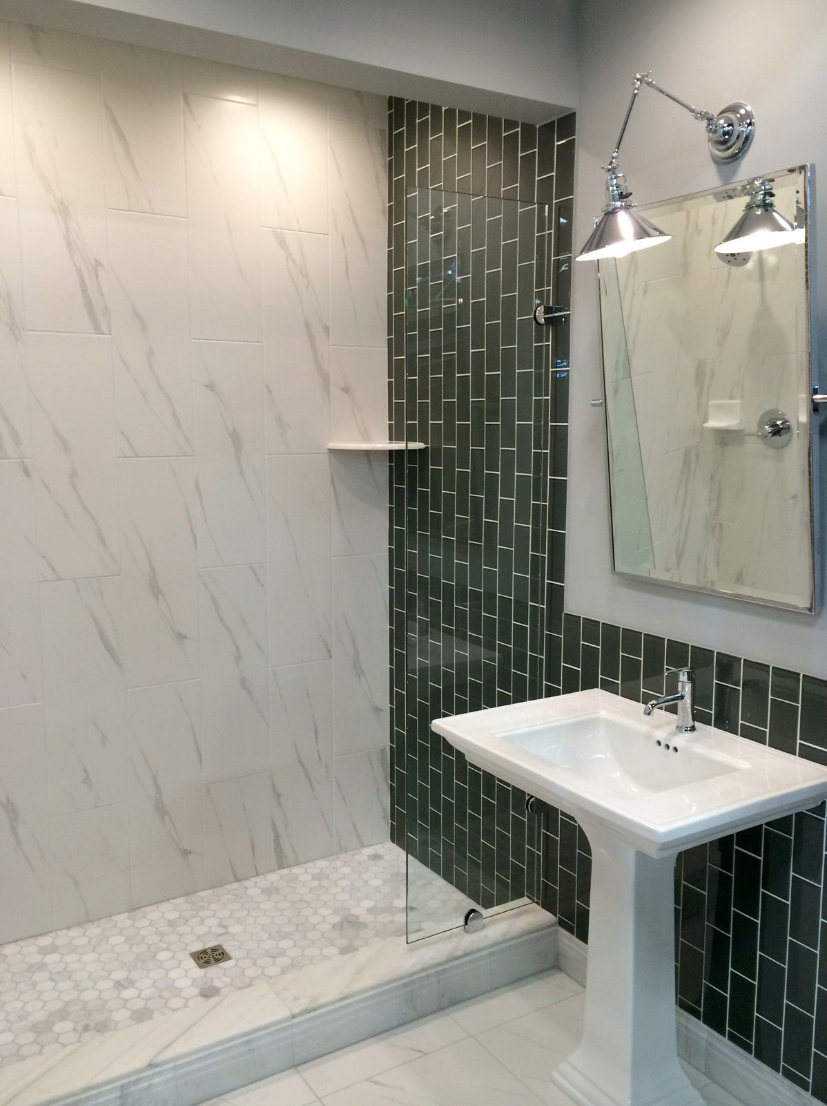 This modern bath uses marble floors with ceramic and glass wall this modern bath uses marble floors with ceramic and glass wall tiles vertically installed antique moss subway tile and the elegance ceramic which dailygadgetfo Image collections