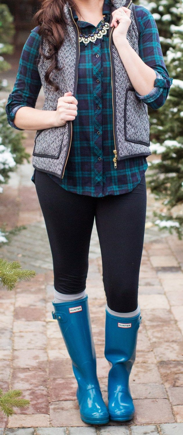 leggings and hunter boots styled with plaid and a herringbone vest for Christmas pictures
