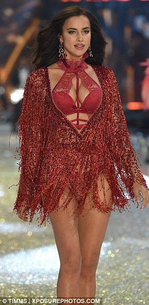 8b112f371c6a Cheeky: The sparkling jacket hid her stomach as she stormed along the  runway, while showcasing her pert posterior