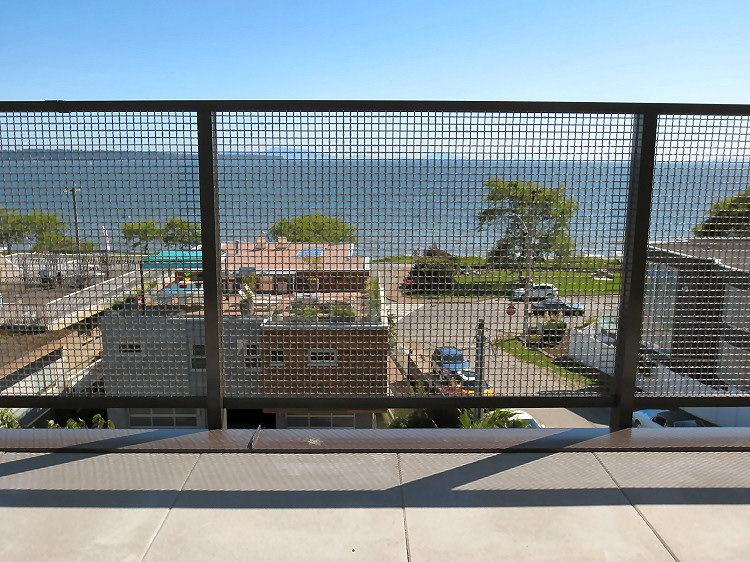 Aluminum deck railings with steel wire woven mesh panels | Nelson ...