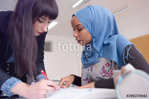 Female Architecture teacher at work Female professor explain architectural projects to students Beautiful female university architecture professor explain lessons to mult...