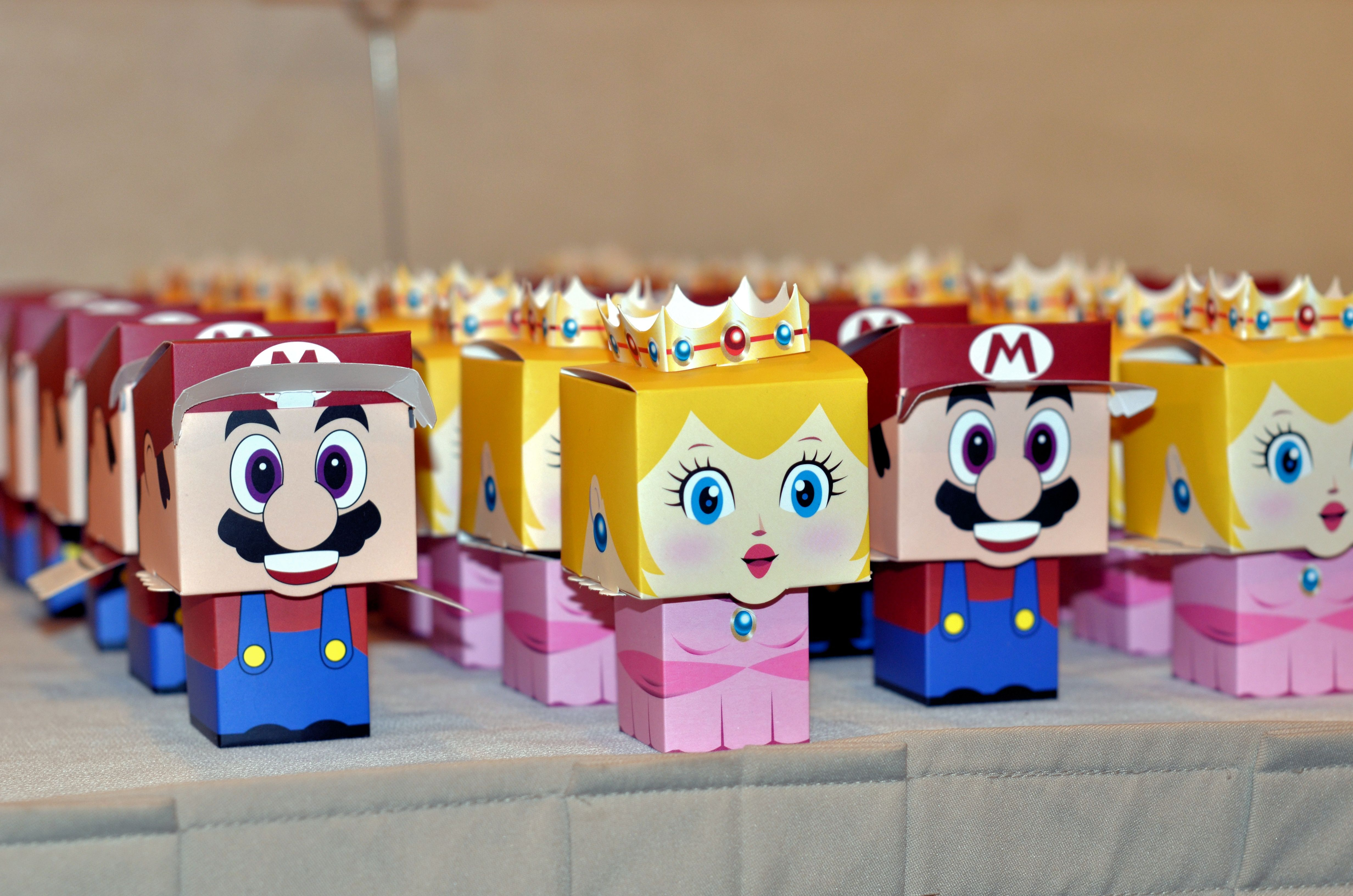 We made lego shaped chocolates and included custom dice inside the Mario and Princess favor boxes