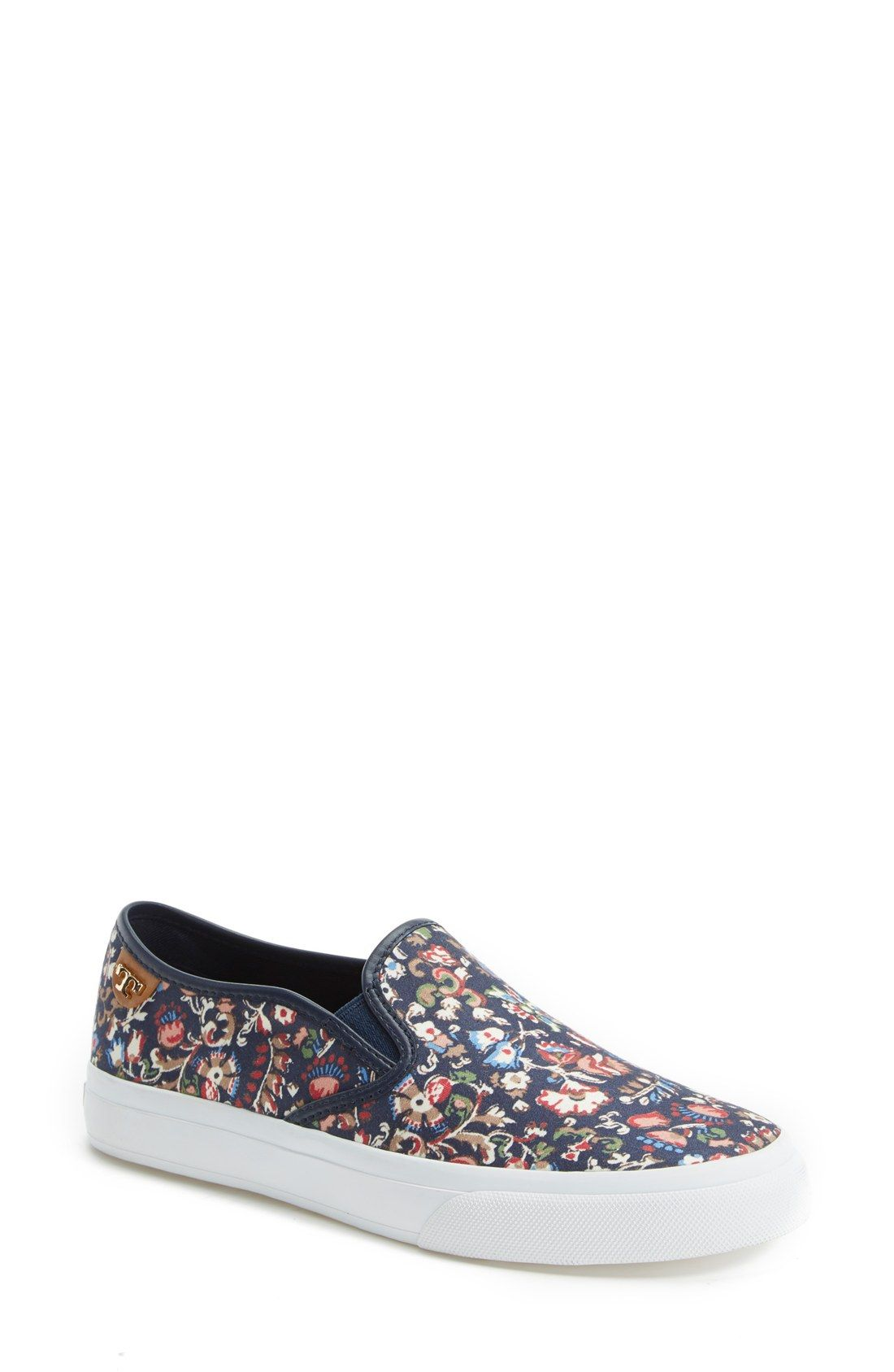 2bd232413ae These floral Tory Burch sneakers would look so cute paired with distressed  boyfriend jeans and a relaxed tee.