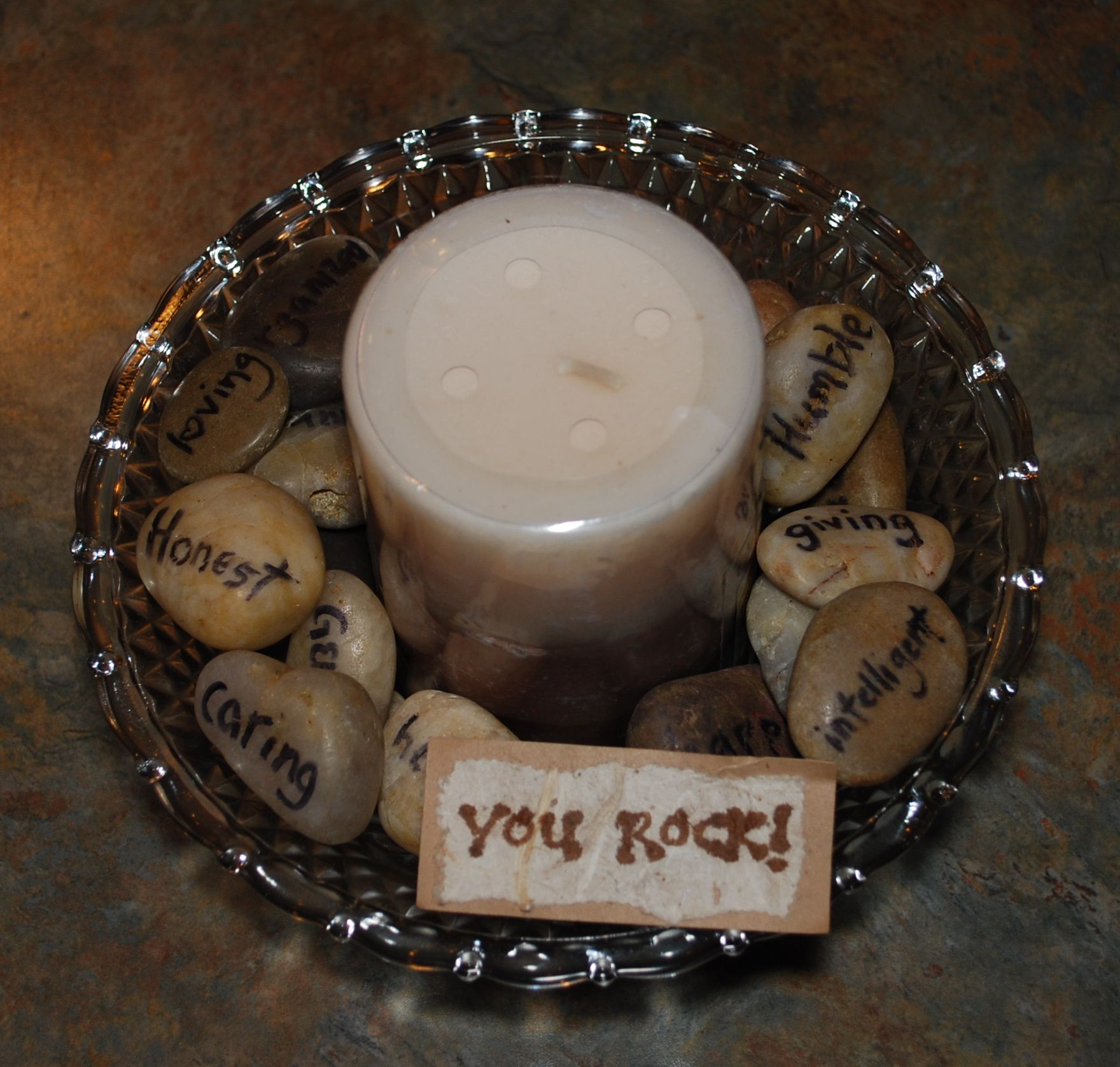 A Handmade Thank You Gift With Handwritten Words On Stones