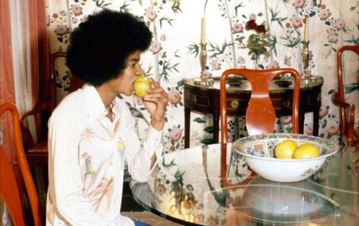 Michael eating in his New York apartment