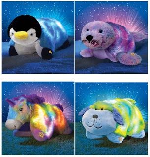 Glow Pets. If you don`t know what the heck these things are, they are pillow animals that glow. By the people that made pillow pets, they are soft furry animals that glow! I have the Glowing Dog.