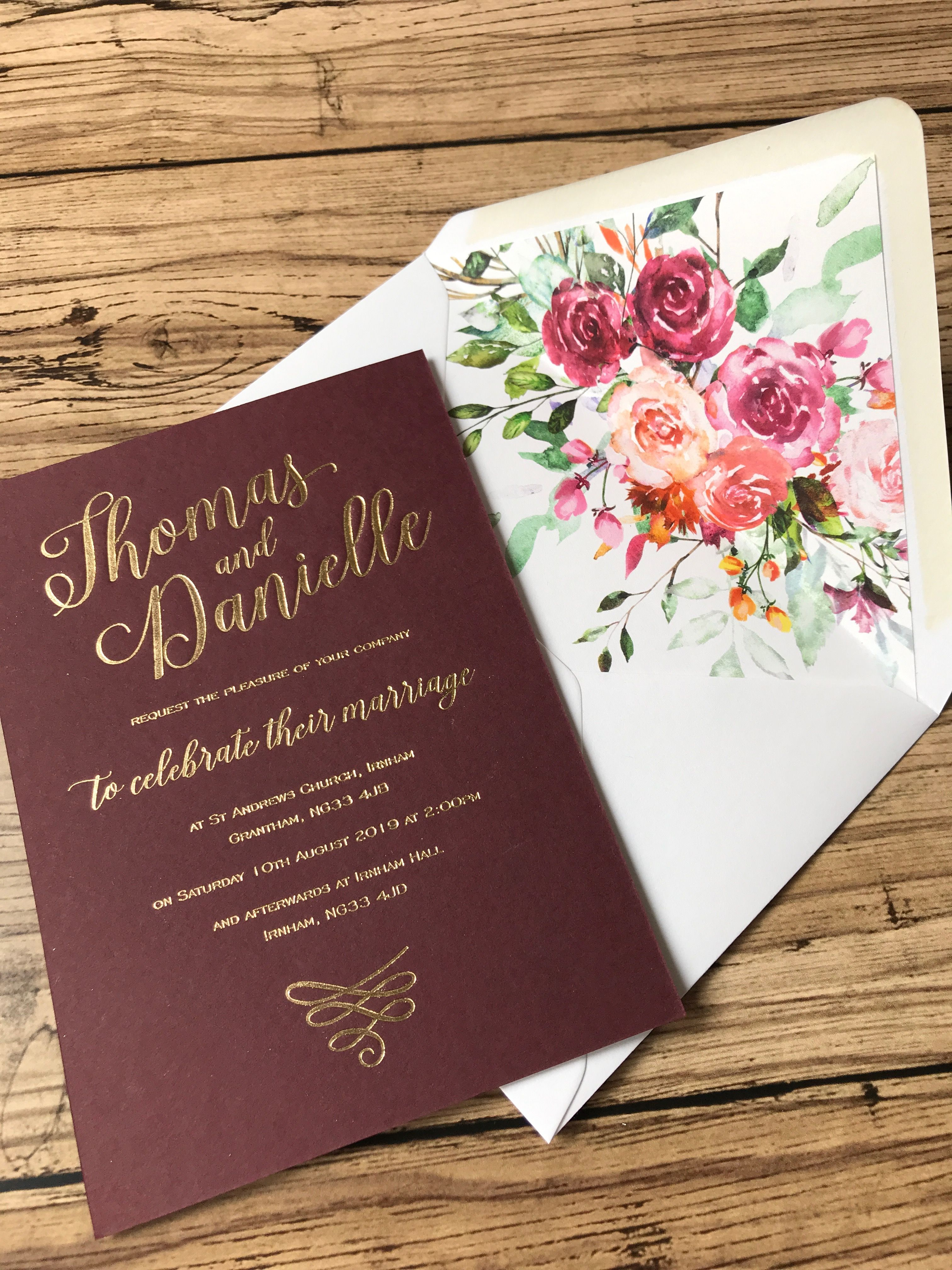 Burgundy and gold foiled wedding invitation with burgundy