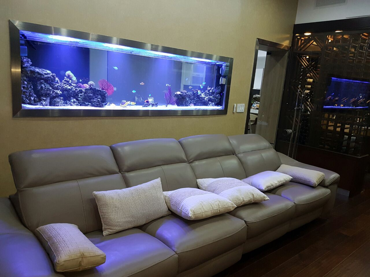 beautiful two side reef aquarium that connects the living room